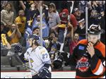 Toledo's A.J. Jenks cheers after Toledo scores a goal during the third period of Game 1 in the second-round playoff series against Fort Wayne.
