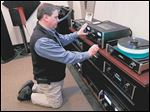 Jamiesons' Audio Video sales rep T.J. Kruse plays a selection of music on three different formats: MP3, record player and CD.