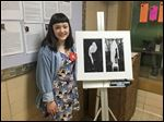 Jessica Kona-Stanciu was among many Ottawa Hills art students to give presentations on their artwork at the 10th annual smART show. More than 800 pieces were displayed, and musical performances were ongoing as well.
