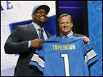 Duke offensive lineman Laken Tomlinson poses for photos with NFL commissioner Roger Goodell after being selected by the Detroit Lions as the 28th pick in the first round of the 2015 NFL Draft,  Thursday in Chicago.