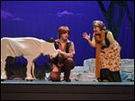 The Baker's Wife (Erin Wiley of Maumee) tries to get Jack (Steven Kiss of Lambertville) to part with his cow in the Croswell Opera House's production of 'Into the Woods.'
