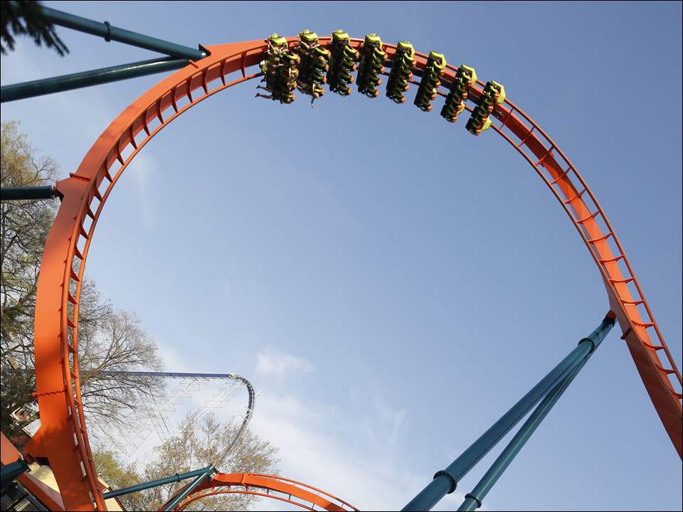 People ride the Rougarou at Cedar Point.