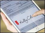 Adobe's Acrobat DC Fill & Sign app for tablets allows users to take a photo and digitally sign documents, which can then be emailed.