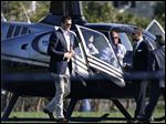 New England Patriots quarterback Tom Brady arrives by helicopter for a speaking event today at Salem State University in Salem, Mass.