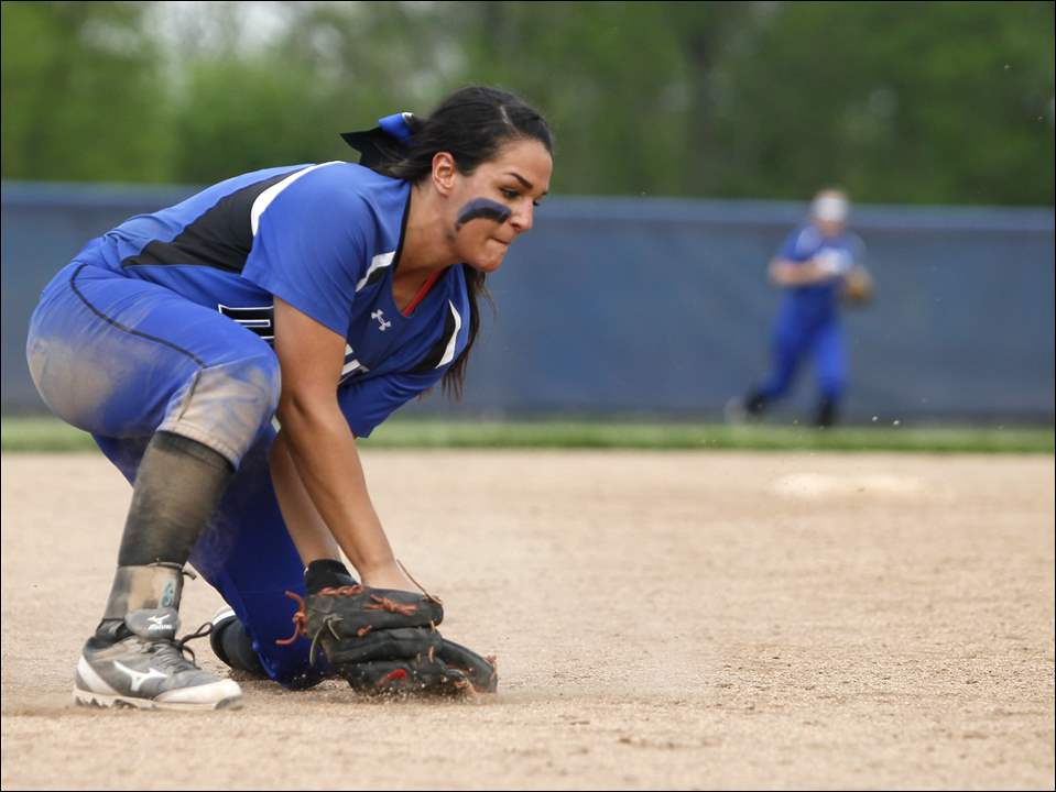 Springfield shortstop Hannah Girlie scoops up a grounder.