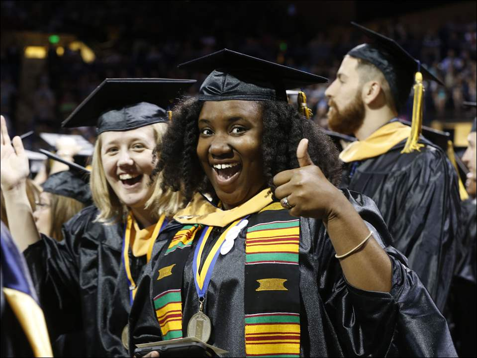 Andrea Leslie, left, and Fanell Williams, both of Toledo, earned their Masters of Art in Social Work.