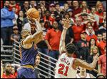 The Cavaliers' LeBron James, left, shoots the game-winning shot against the Bulls' Jimmy Butler late in the second half of Game 4.