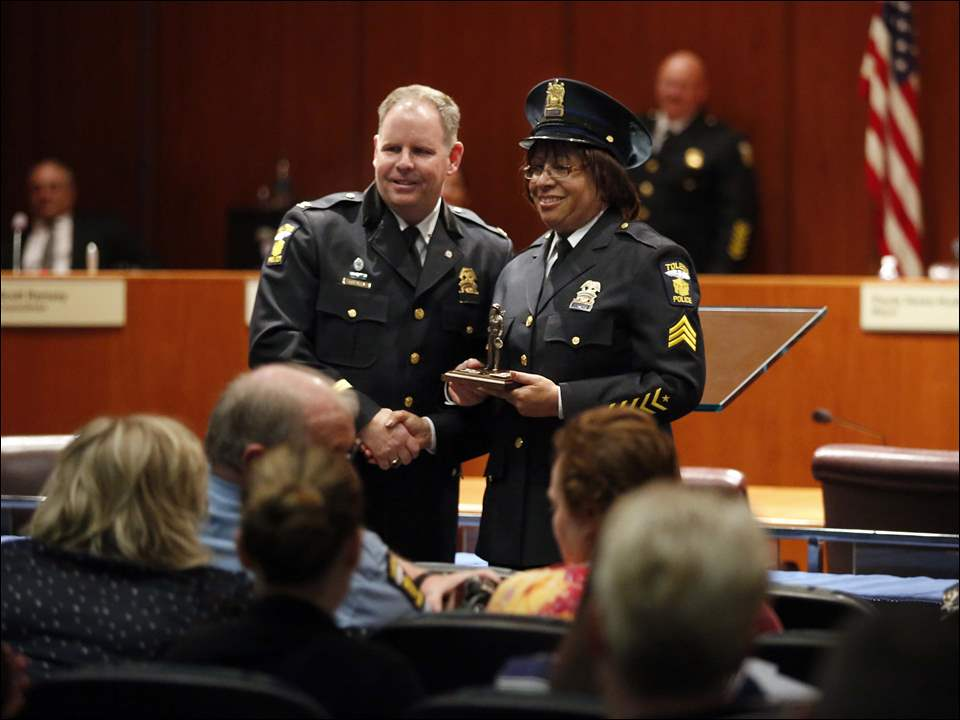 Toledo Police Chief George Kral congratulates Sgt. Angela Jones-Crooks, right, for her Command Officer of the Year award.