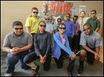 Chase STEM Academy principal Jack Hunter, rear and left, and teacher Luke McKinley. From left, middle row: Anthony Strunk, Jeffrey Riebe, Aiden Barbee, Thomas Stigall, Juamayla Ensley, Kaveon McCoy. From left, front: Cordell Carpenter, MaQuaia Hudgins, Moshantee Horn, Te'sean Lamonds. ChaseSS won The Blade stock contest finishing with $52,378.