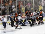 Officials try to break up a scrum between Walleye and Fort Wayne Komets players during a game in Toledo. Game 7 is tonight at the Huntington Center.