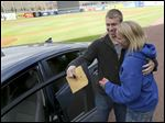 Bowsher High School senior Conor Kaczmarek, 18, is congratulated by his aunt, Kim Bais, after winning a 2015 Kia Forte at Fifth Third Field.