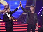 Ryan Seacrest, left, announces Nick Fradiani the winner at the American Idol XIV finale at the Dolby Theatre on Wednesday in Los Angeles.