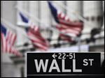 FILE - This April 22, 2010, file photo, shows a Wall Street sign in front of the New York Stock Exchange. Stocks are rising in early trading on Wall Street Thursday, May 14, 2015, snapping a three-day losing streak. (AP Photo/Mark Lennihan, File)