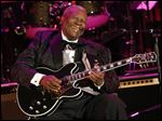 Musician B.B. King performs at the opening night of the 87th season of the Hollywood Bowl in Los Angeles in June, 2008.  King died Thursday peacefully in his sleep at his Las Vegas home at age 89, his lawyer said.