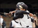 Perrysburg's Chaz Westfall, left, congratulates closer Kaleb Mahler after the Yellow Jackets defeated Clay on Thursday.