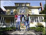 The Rye family, from left, Jane, 2, Jamie, Jonah, 5, and Kelly, lives in a 3,400-square-foot home on Glenwood Avenue that they to move into a  a 400-square-foot 'tiny house.'