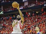 The Rockets' James Harden shoots against the Clippers in Game 7. He finished with 31 points in the win.