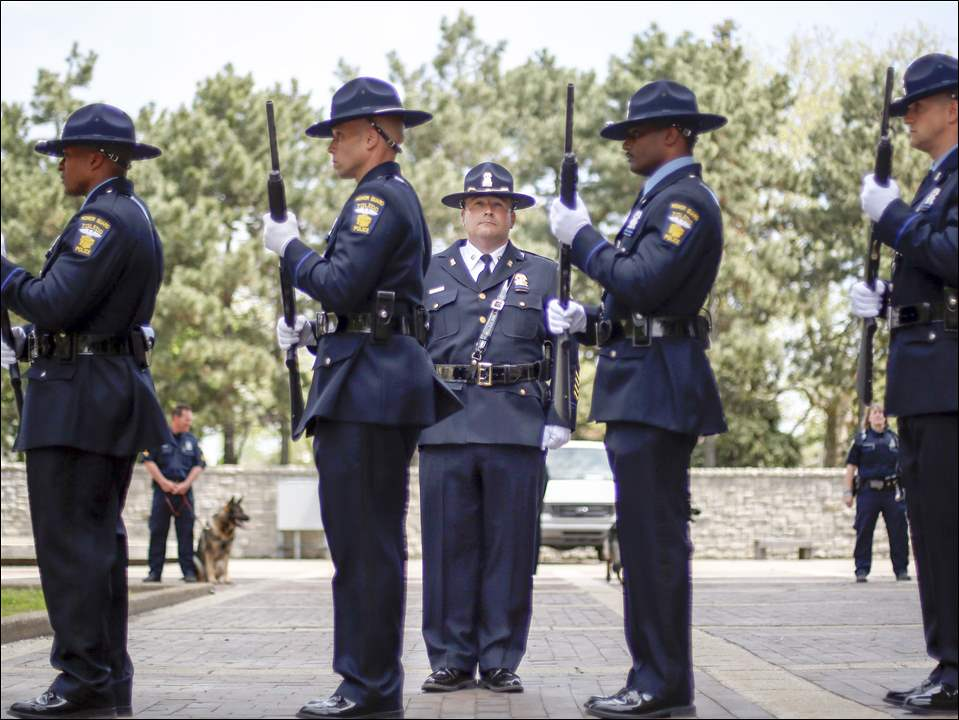 Lt. Ron Frederick, center, with the Toledo Honor Guard during the annual Toledo Area Police Memorial Service in the Toledo Police Memorial Garden on May 11, 2015.
