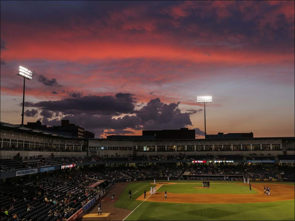 The sky turns dramatic as the Toledo Mud Hens load the bases against the Gwinnett Braves during the eighth inning.