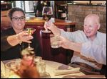 Jessica Ford and Carty Finkbeiner toast the late Jack Ford, Jessica's father, at J Alexander's restaurant on Monday, which would have been Mr. Ford's birthday.  If Mr. Finkbeiner decides to enter the mayoral race, he won't be alone.