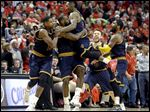 Cleveland's LeBron James, second from left, hugs teammate J.R. Smith, as they celebrate beating the Bulls in Game 4.