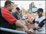 Mud Hens shortstop Dixon Machado signs autographs for fans at Fifth Third Field, where he has turned in many defensive highlights.