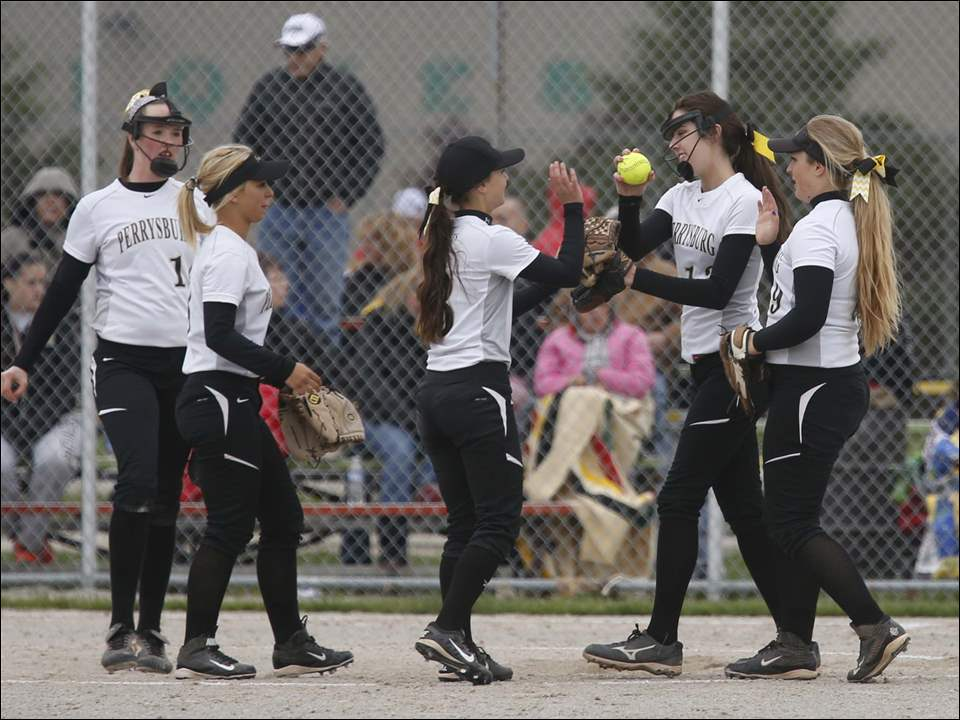 Perrysburg pitcher Brianna Pratt, with ball, is met on the mound after striking out a Notre Dame batter.