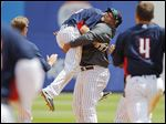 Toledo pitcher Melvin Mercedes lifts teammate Josh Wilson after Wilson delivered the game-winning hit on Wednesday.
