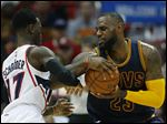 Cleveland Cavaliers forward LeBron James (23) drives against Atlanta Hawks guard Dennis Schroder (17).