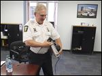 Toledo Deputy Police Chief Don Kenney turns in some equipment Thursday as he prepares for his retirement. Today is his last day on the job.