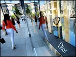 Shoppers walk past a Dior luxury goods shop on Rodeo Drive in Beverly Hills, Calif. in April.