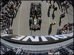 In this photo taken with a fisheye lens, the car driven by Townsend Bell is pulled to the pit before the start of the final practice session for the Indianapolis 500 auto race at Indianapolis Motor Speedway in Indianapolis, today.
