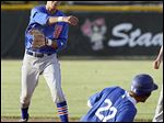 St. Francis' Casey Johnson turns a double play as AW's Alex Vogel slides into second base in the second inning.