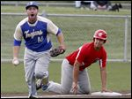 Findlay third baseman Wes Breitigam, left, tags out Central Catholic's George Meyer.