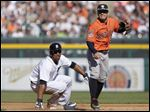 Detroit Tigers' Anthony Gose, left, and Houston Astros second baseman Jose Altuve, right, look to first base after Gose was forced out for the second out of a triple play during the fifth inning of a baseball game Saturday, May 23, 2015, in Detroit. It was the Astros' first triple play since 2004. The Astros defeated the Tigers 3-2. (AP Photo/Duane Burleson)