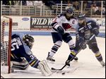 Walleye goalie Neil Conway and defenseman Cody Lampl block South Carolina's Andrew Rowe shot on goal Friday. Conway finished with 26 saves for Toledo as they forced a Game 5 with a 5-4 win.
