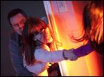 Sam Rockwell, left, as Eric Bowen and Rosemarie DeWitt as his wife, Amy, desperately try to hold on to Kennedi Clements, their youngest daughter Madison, who has been targeted by apparitions in 'Poltergeist.'