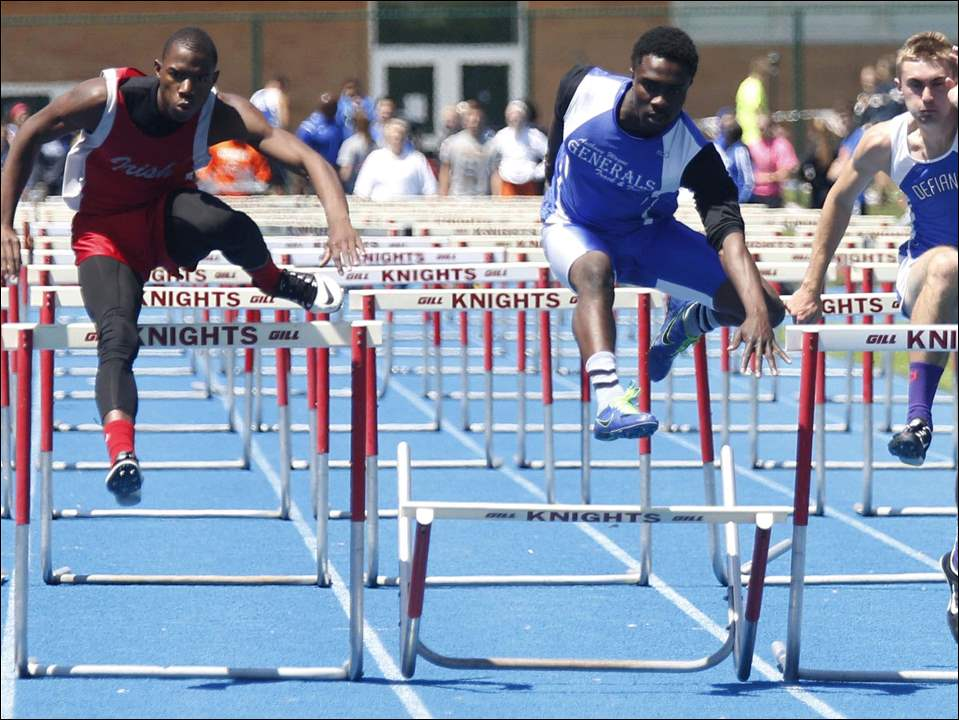 Anthony Wayne's Timothy Osinowo, center, wins the boys 110 meter hurdles.
