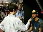 Patrick Andres, a McCord student, interviews Kentucky star Willie Cauley-Stein after the Wildcats earned a trip to the Final Four.