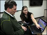 David Stuczynski, who has ALS, works with Katie Boarman, supervisor of clinical instruction at the University of Akron School of Speech-Language Pathology and Audiology, on learning to use the computer to speak.