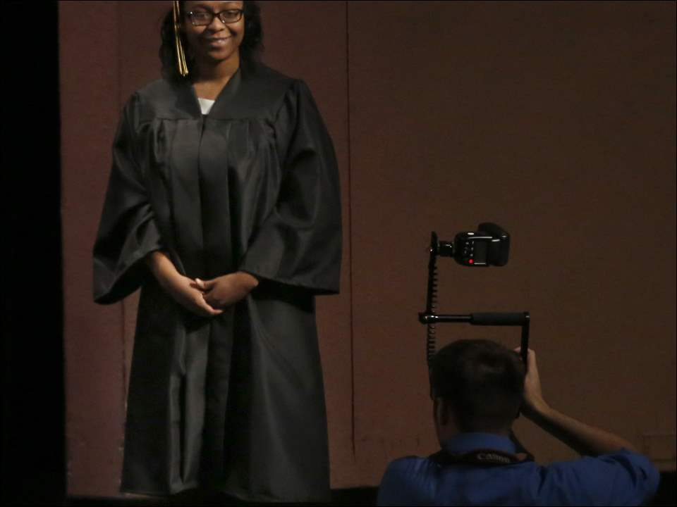 Lauren Cherie Bland stands for a graduation photo before receiving her diploma during Perrysburg High School's 150th Commencement, marking the Class of 2015 at the Stranahan Theater & Great Hall on Sunday.