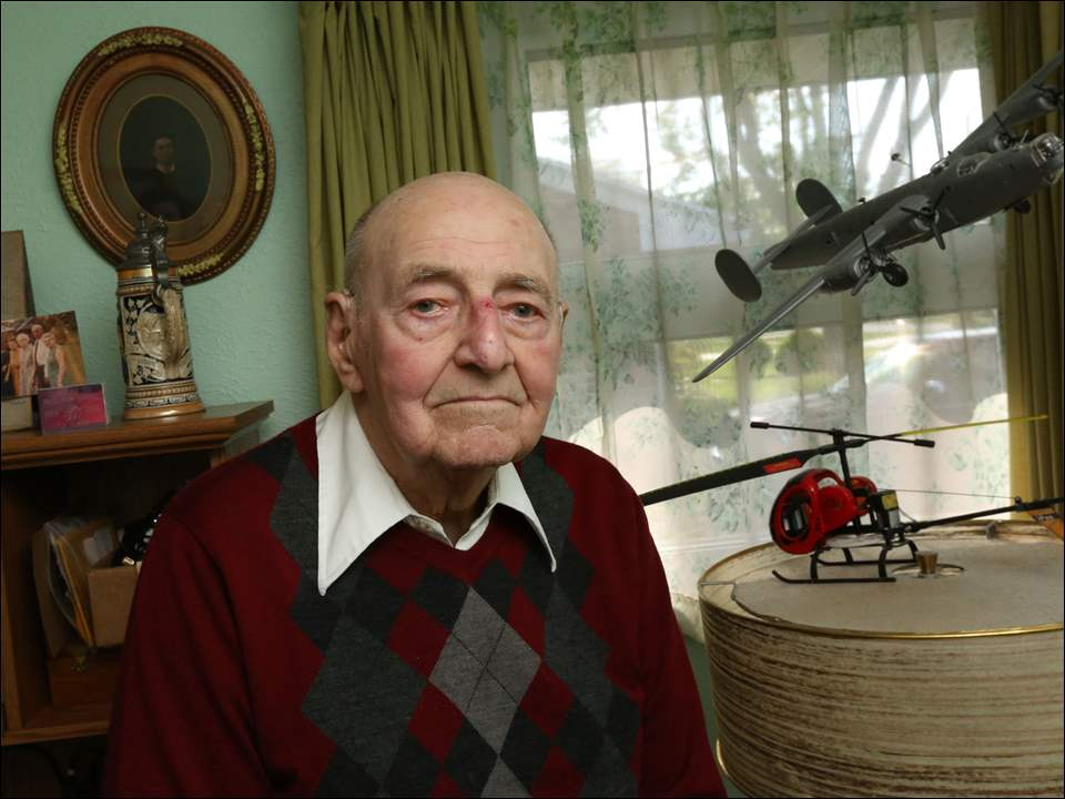 Geisert's home office is decorated with photographs, documents and mementos from his service years, including a model of the plane he few in the war, a B-24 bomber.