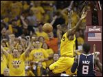 Cleveland Cavaliers' LeBron James finishes a dunk against the Atlanta Hawks during the first half in Game 3 of the Eastern Conference finals on Sunday in Cleveland.