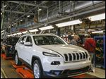 Jeep Cherokee production will move from Toledo to a plant elsewhere, possibly in Michigan.