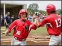 Central Catholic's Jayson Cleghorn (30) high fives Jonathon Plasencio (13) after scoring the go-ahead run against  St. Francis during the eighth inning of the TRAC baseball semifinals on Monday at Mercy Field in Toledo. Central