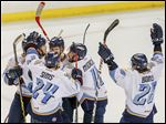 The Walleye celebrate A.J. Jenks goal during Game 2 of the Eastern Conference finals in Toledo. The Walleye lost the first three games of the series before winning the last two.
