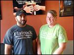 Lawrence Pritchard III and his wife Rachel in the lobby at Flatrock Brewing Company Taproom & Bottle Shop.