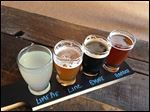 Beer sampler flavors include from left, Lime Pie, Line, S'more, and Harbor.