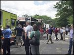 Patrons visit food trucks Wednesday in Arrowhead Park in Maumee. The Arrowhead Park Picnic is every Wednesday.