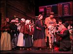 Paul Causman was Ebenezer Scrooge, far right, and Gabe Omlor was Tiny Tim in the Rep's 2014 production of  'A Christmas Carol.' The play has been a tradition since 1985.